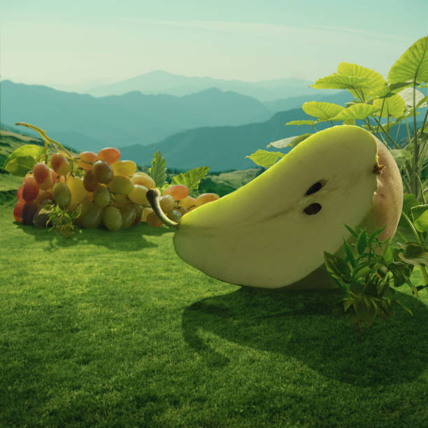 surreal giant pear and grapes at mountain field - surrealistyczny zdjęcia i obrazy z banku zdjęć