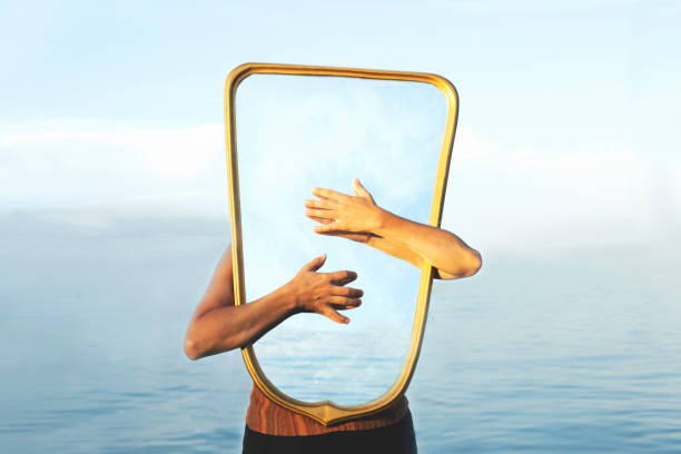 surreal image of a transparent mirror; concept of door to freedom and imagination stock photo