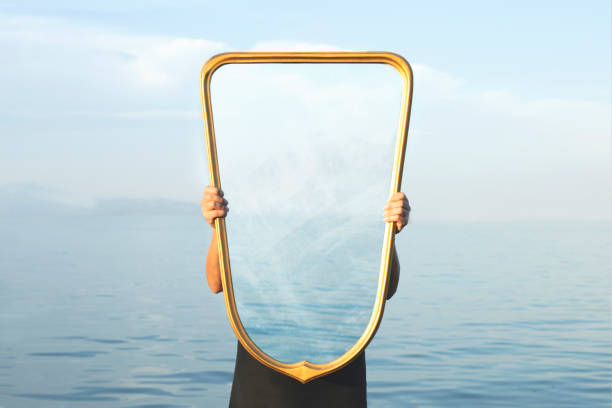 surreal image of a transparent mirror; concept of door to freedom stock photo