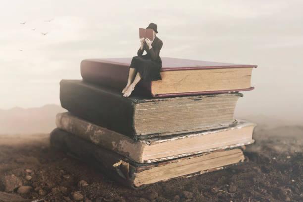 surreal image of a woman reading sitting on top of a book - surrealistyczny zdjęcia i obrazy z banku zdjęć