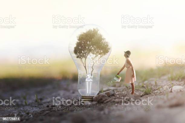 Surreal image of a woman watering her plant that needs energy to a picture id982726614?b=1&k=6&m=982726614&s=612x612&h=xqpeoy7wqk guul haj6aovbnbyopjjswjqjdpxxf 4=