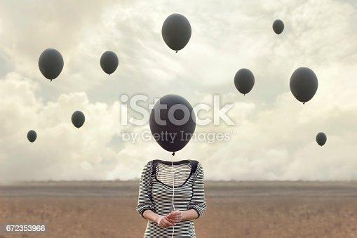 istock surreal image of woman and blacks balloons flying 672353966