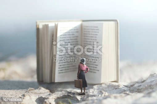 istock surreal journey of a woman inside the story of an adventurous book 1071659368
