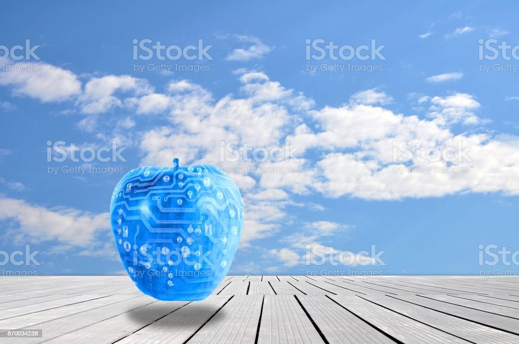 Surreal landscape with cloudy sky and blue electronic apple. stock photo