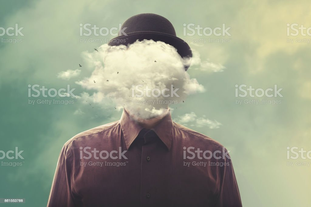 surreal man head in the cloud stock photo