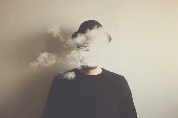 surreal man head in the clouds, abstract concept stock photo