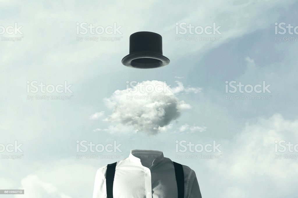 surreal man heads in the clouds stock photo