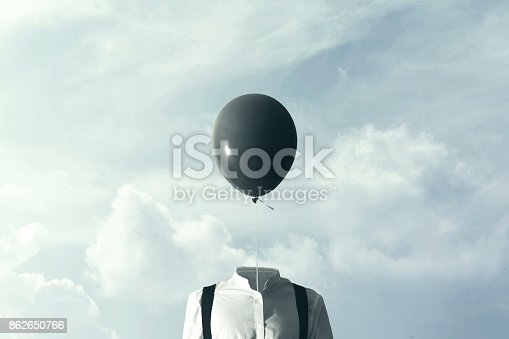 861862204 istock photo surreal man with big black balloon suspended over his head 862650766