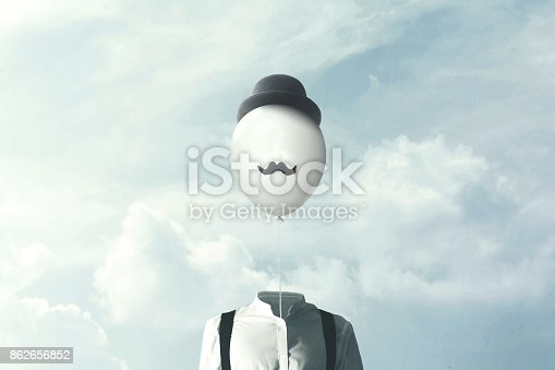 861862204 istock photo surreal man with big black balloon suspended over his head 862656852