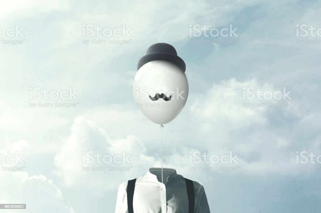 surreal man with big black balloon suspended over his head stock photo