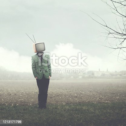 man walking on field with television on his head
