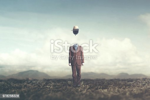 861862204 istock photo surreal minimalist man with big black balloon suspended over his head 978258328