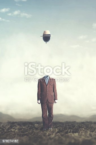 861862204 istock photo surreal minimalist man with big black balloon suspended over his head 978274182