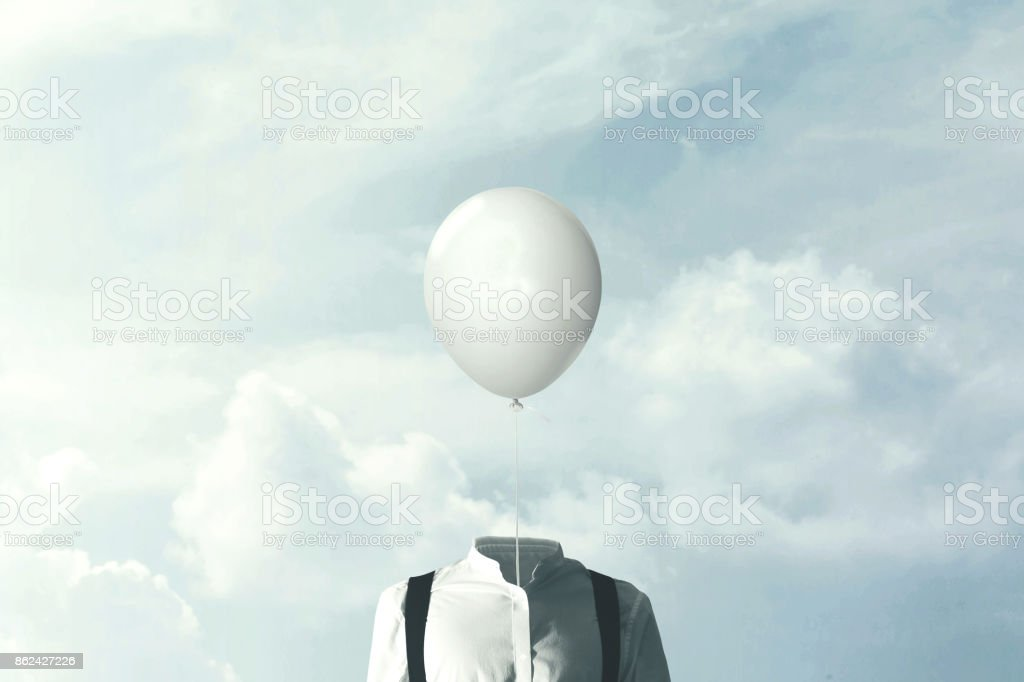 surreal minimalist man with big white balloon suspended over his head stock photo