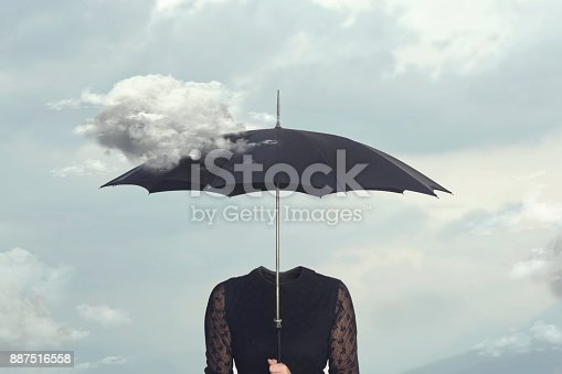 istock surreal moment of a cloud caressing the umbrella of a headless woman 887516558