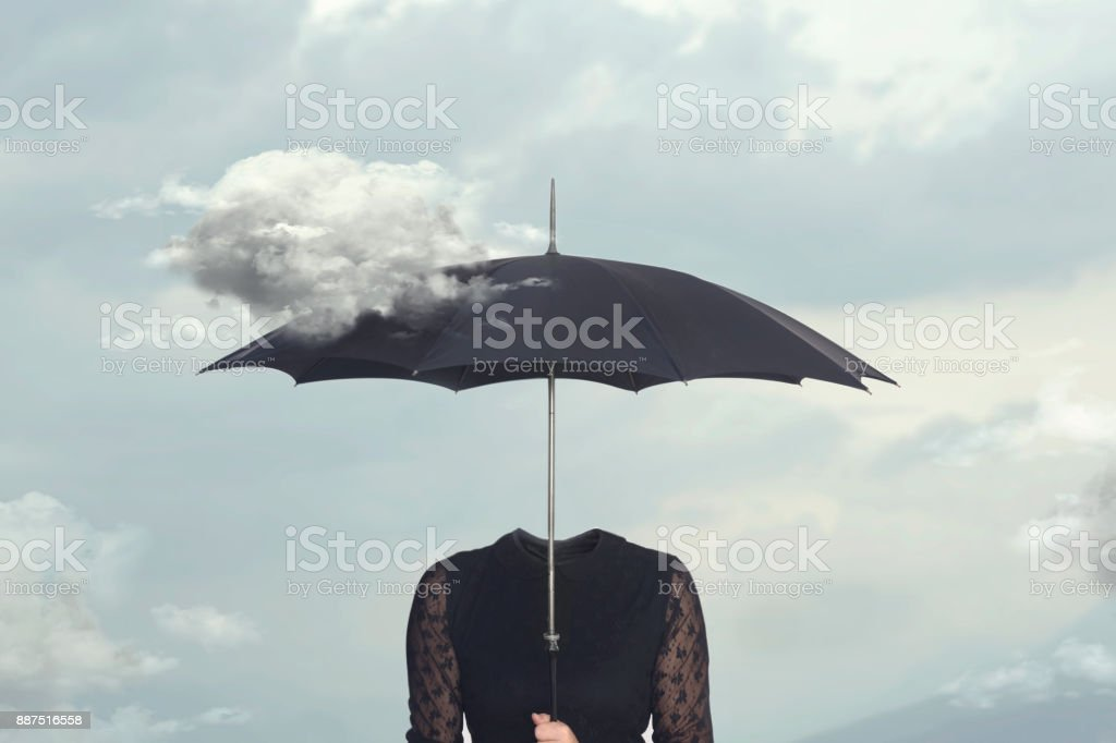 surreal moment of a cloud caressing the umbrella of a headless woman stock photo
