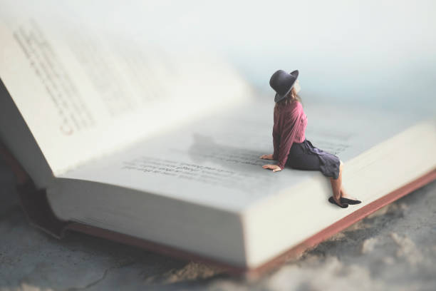 surreal moment of a woman relaxes sitting on a giant book surreal moment of a woman relaxes sitting on a giant book giant fictional character stock pictures, royalty-free photos & images
