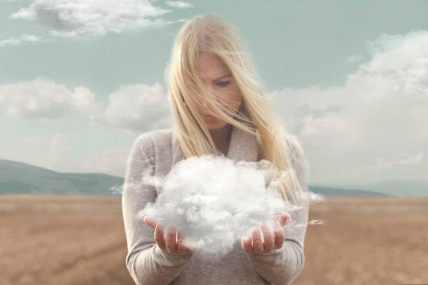 surreal moment , woman holding in her hands a soft cloud - illusion stock photos and pictures