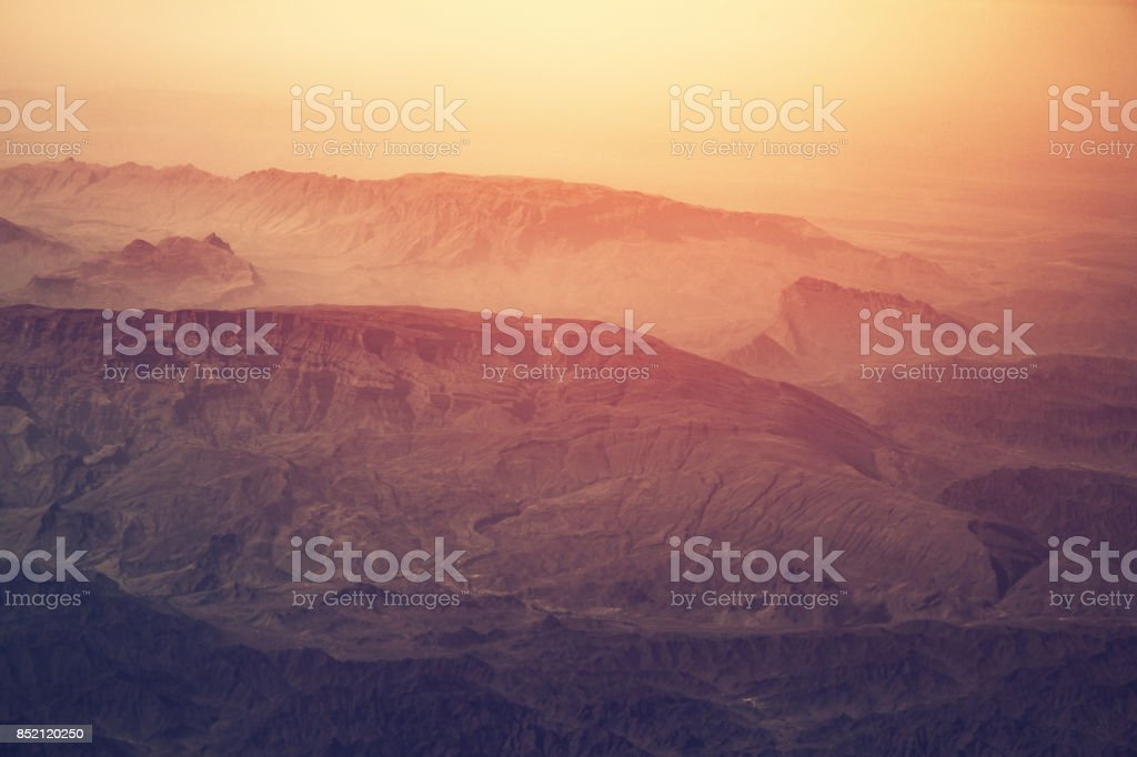 Surreal mountains landscape in fog stock photo