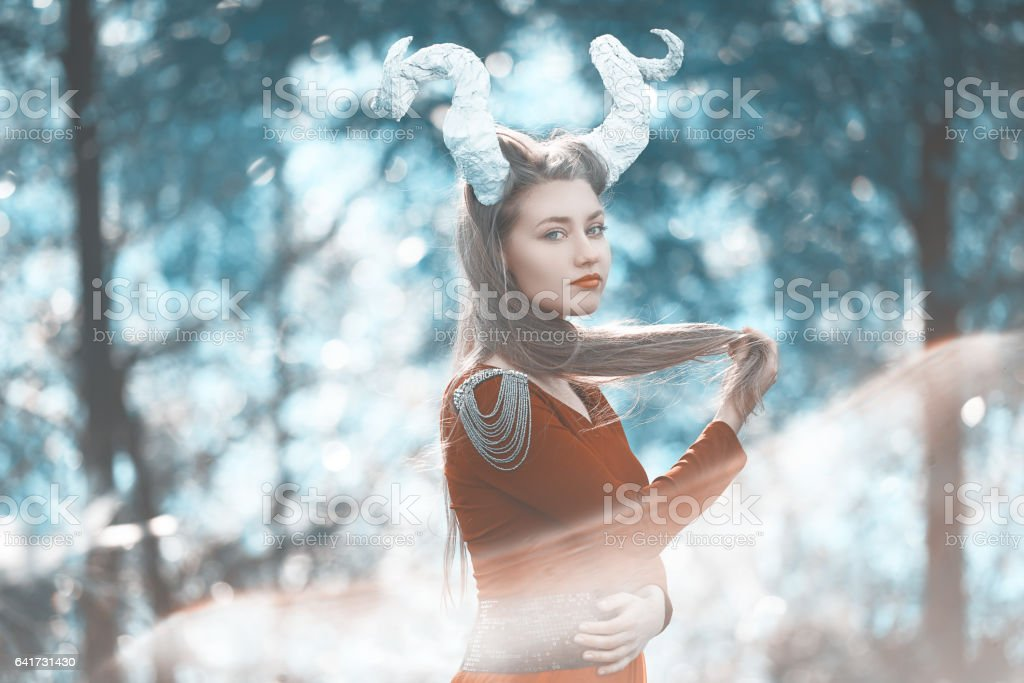 surreal nymph in the forest stock photo