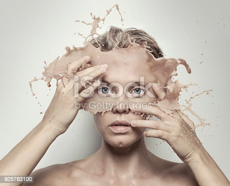 istock surreal portrait of girl with melted face 925763100
