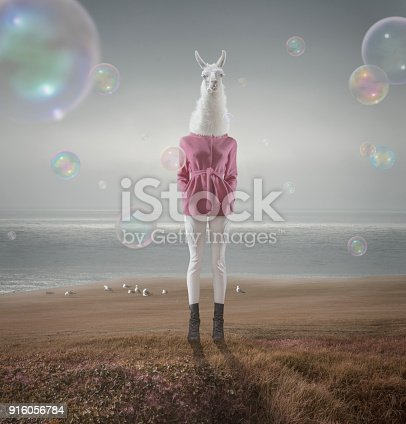 istock Surreal portrait of white lama girl 916056784