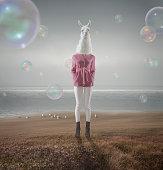Surreal portrait of white lama girl