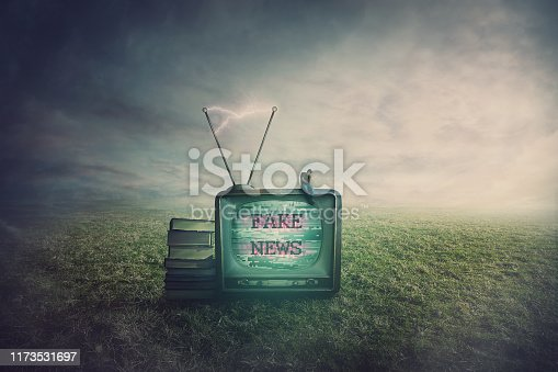 Surreal scene as a minuscule man seated on an old TV box in a open field, feeling disappointed of the fake news. Television manipulation and brainwashing concept. Mass media propaganda control.