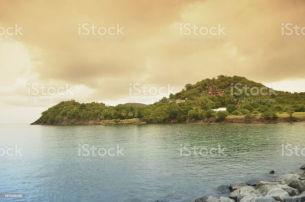 surreal scenic beach and promontory royalty-free stock photo