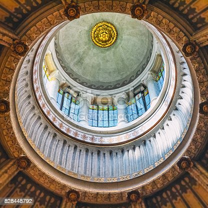 istock Surreal view of geometric shapes of cupola ceiling architecture of french Ars-Sur-Formans Basilica famous religious church for pilgrims 828448792