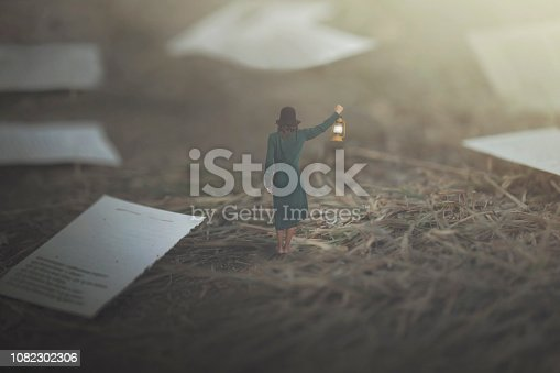 istock Surreal woman decides which page to choose for the end of her book 1082302306