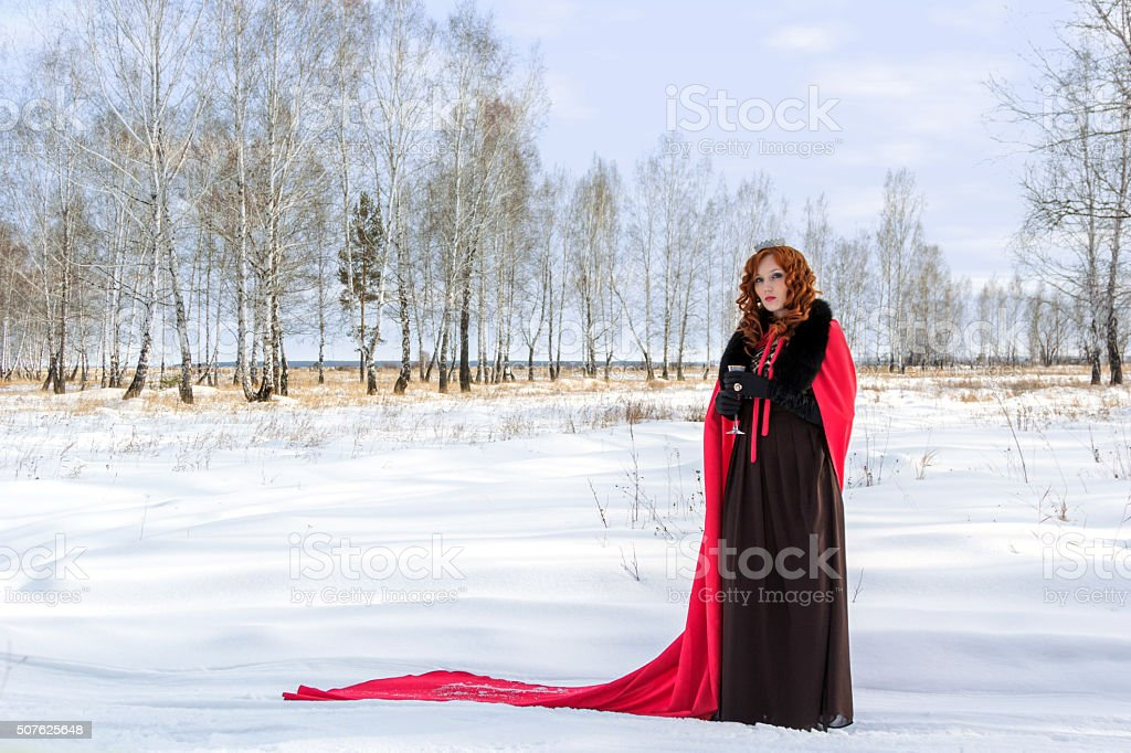 Surrealism. Girl in a red gown stock photo