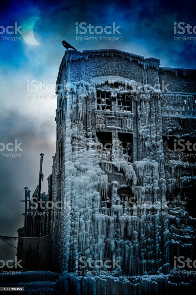 Surrealistic fantasy concept with a vintage building covered in ice, a solar eclipse shaped like the moon, a raven and imprisoned masked spirits. Can be used for halloween or to illustrate depression, nightmares, pain, loss, grief, sadness, loneliness, de stock photo