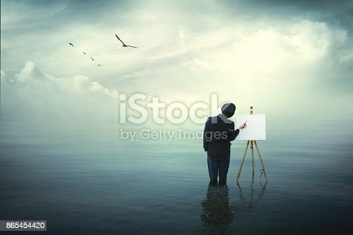istock surrealistic painter artist in the water painting on a canvas 865454420