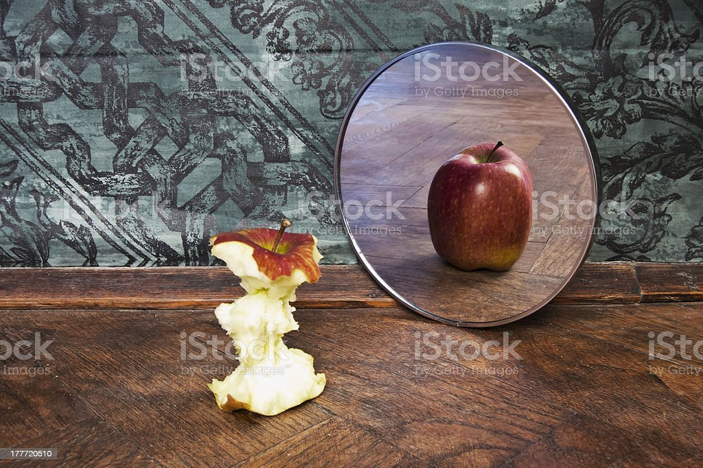 surrealistic picture of an apple reflecting in the mirror stock photo