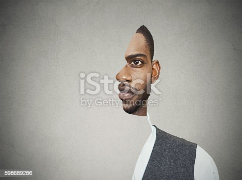 istock surrealistic portrait front with cut out profile of man 598689286