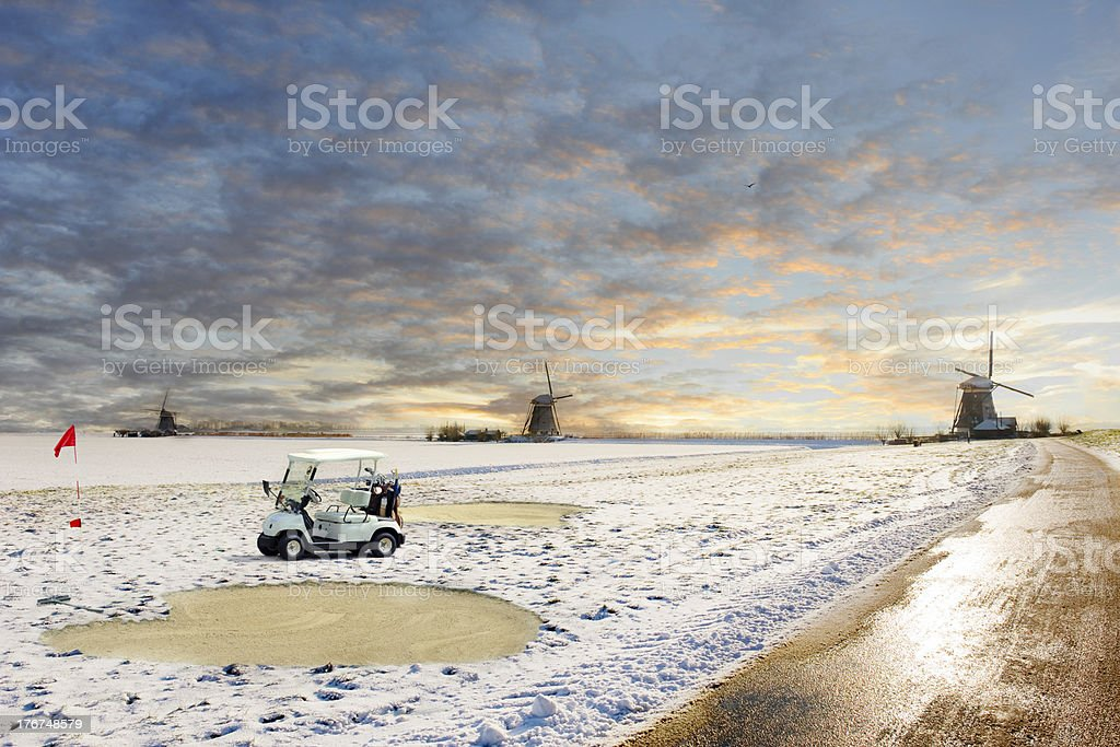 Surrealistic view on a snowed golf course in Winter royalty-free stock photo