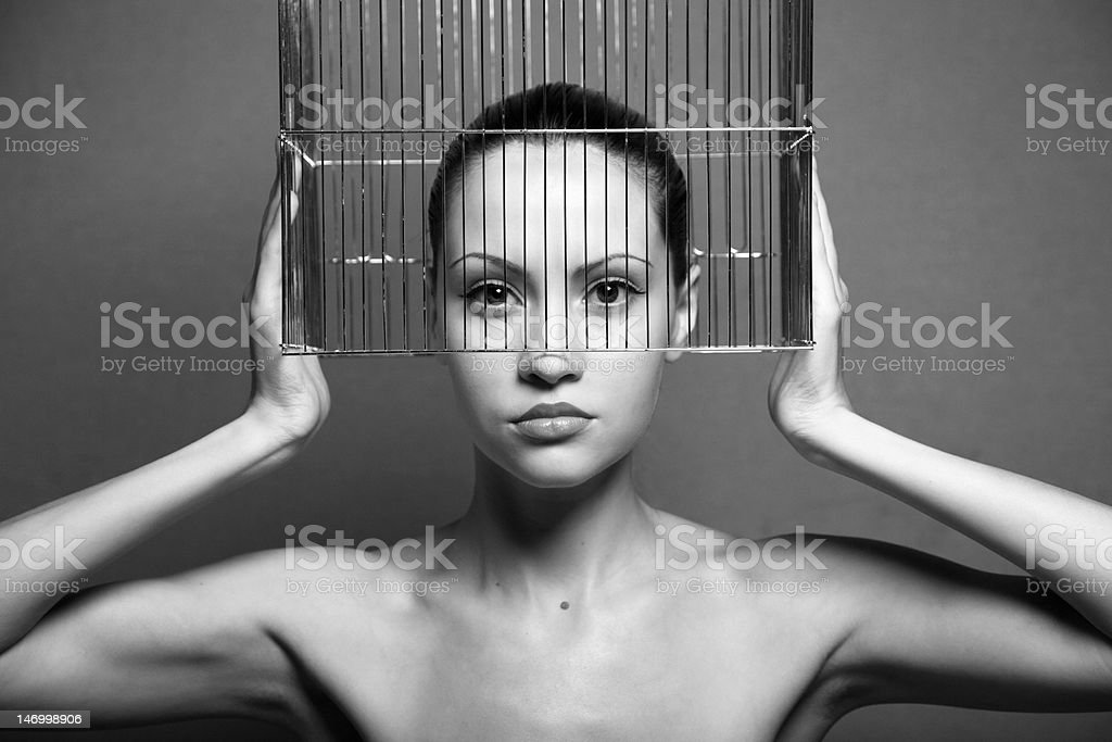 Surrealistic woman with cage stock photo