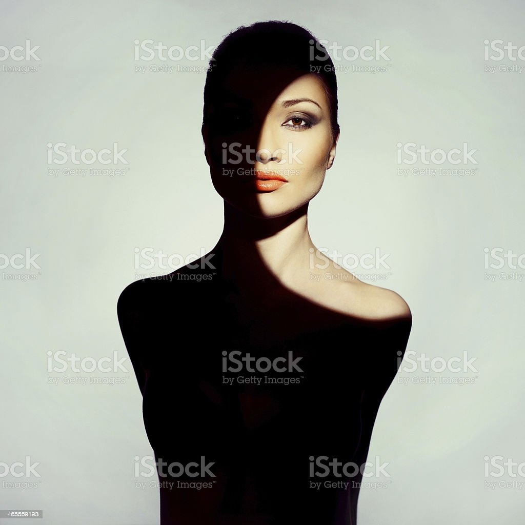 Surrealistic young lady with shadow on her body stock photo