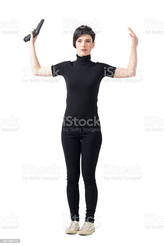 Surrender concept. Scared female spy with raised arms stock photo