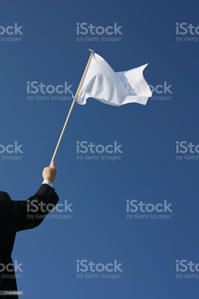 Surrender – Waving the white flag stock photo