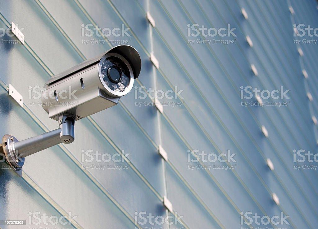 Surveillance Camera On Glass Facade stock photo