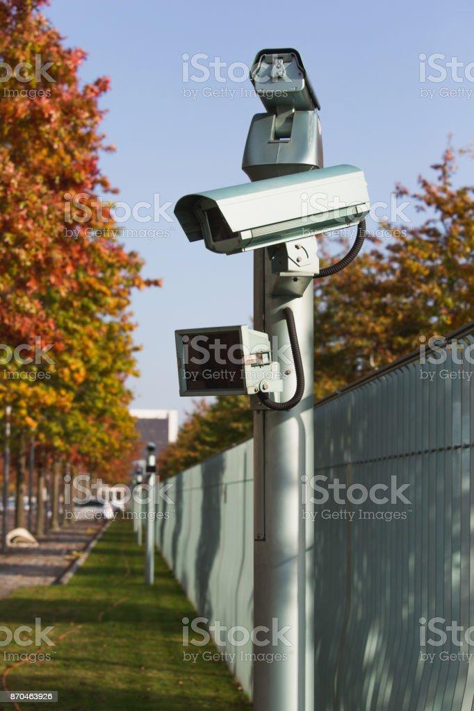 Surveillance camera with motion sensor. stock photo