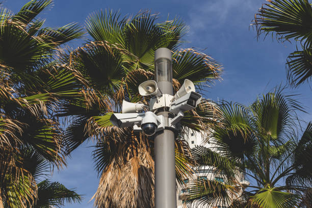 surveillance cameras atop a pole in tel aviv, israel - big brother orwellian concept stock pictures, royalty-free photos & images