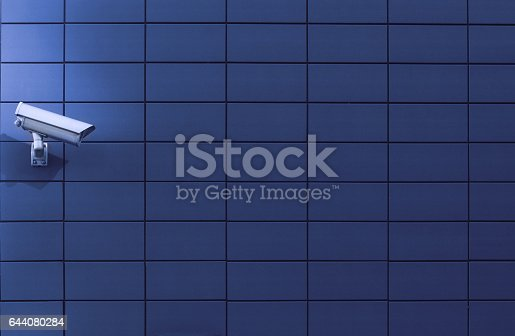 istock Surveillance monitoring camera against a blue wall 644080284