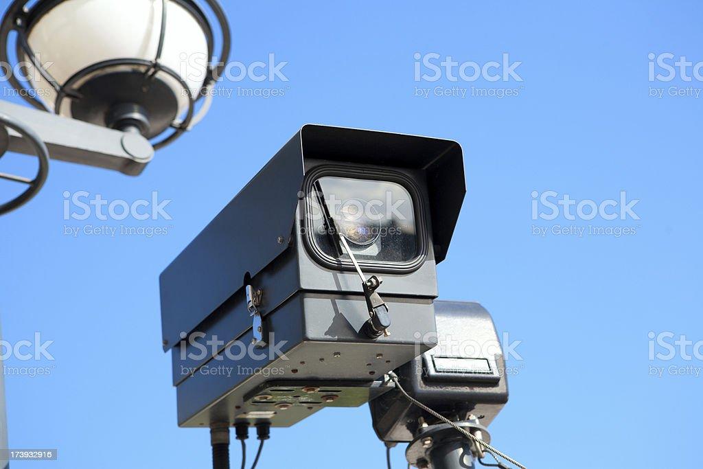 Survelliance Camera Against Blue Sky royalty-free stock photo