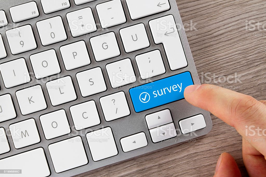 Survey Button on Computer Keyboard stock photo