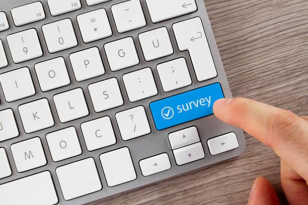 Survey Button on Computer Keyboard stock photo