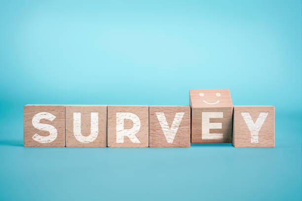 Survey Concept With A Smiley Face On The Blue Background Questionnaire, Surveyor, Anthropomorphic Smiley Face, Analyzing,  Customer Focused survey stock pictures, royalty-free photos & images