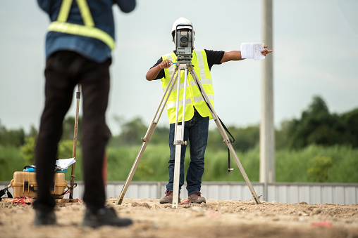 istock survey engineer in construction site use theodolite mark a concrete pile co ordinate 813210666